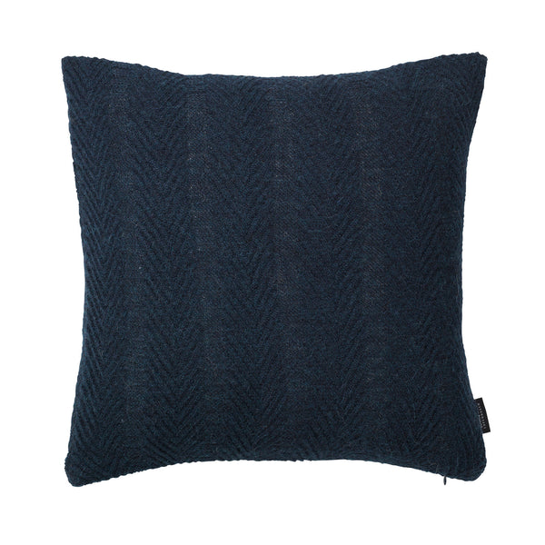 Square knitted baby alpaca wool cushion in blue.