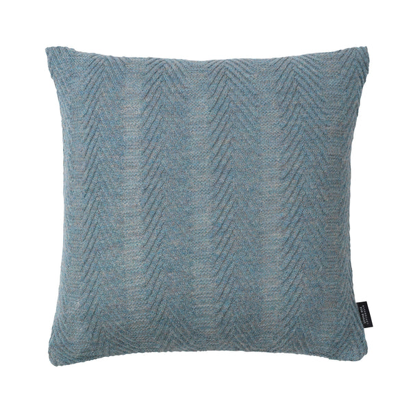 Square knitted baby alpaca wool cushion in antique blue.
