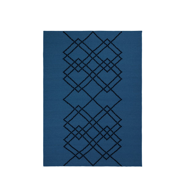 Packshot of royal blue handwoven BORG wool rug with graphic black lines.