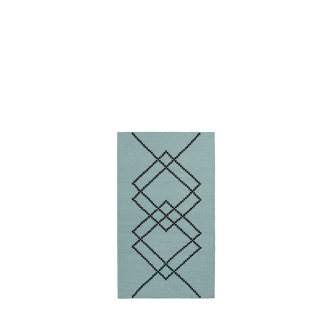 Packshot of vintage green handwoven BORG wool rug with graphic black lines.