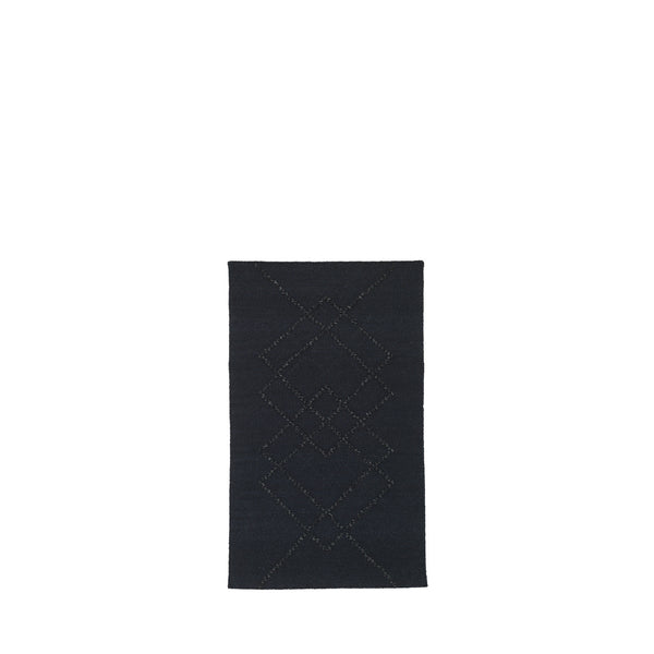 BORG handwoven wool rug in black on black with black graphic lines.