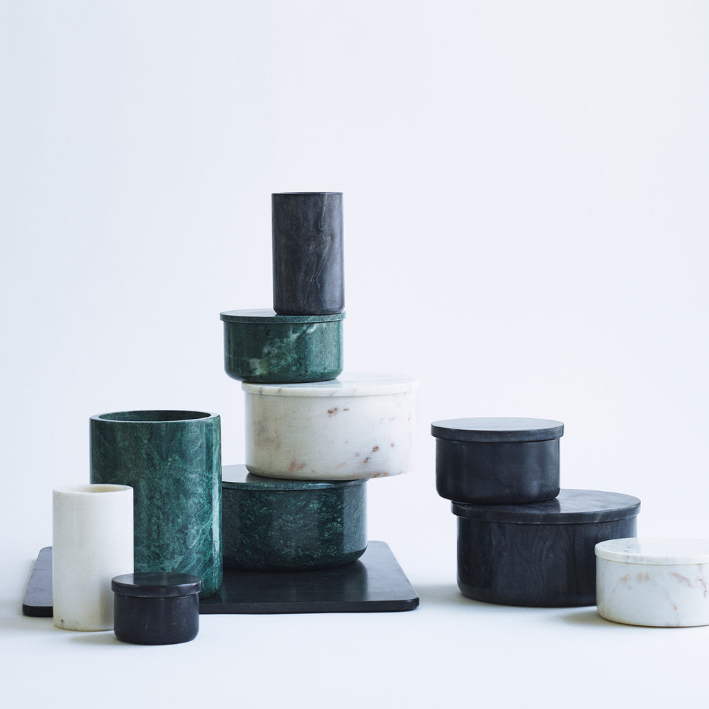 Stacked vases and bowls in green, black and white marble.