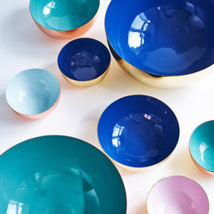 Metal bowls in different colors and sizes.