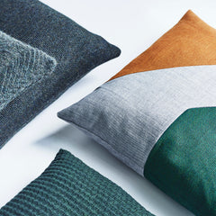 Detail picture of cushions in different shades of green.
