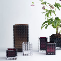 six glass vases in different sizes and colors such as clear, smoke and amethyst.