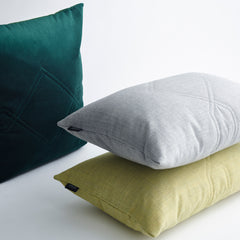 Stacked cotton velvet cushions.
