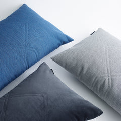 Cotton velvet cushions in remix blue, dark blue and grey.