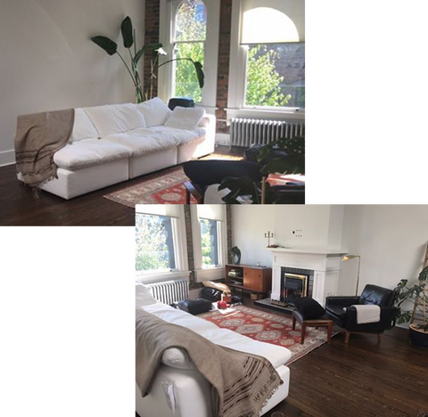 a bright apartment with dark wooden floorboards and a bright white linen sofa. A pink antique rug sits in the centre of the room with a dark leather armchair on one corner