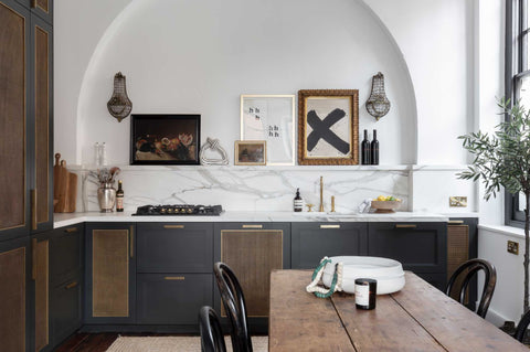 kitchen with brass accents and white arch
