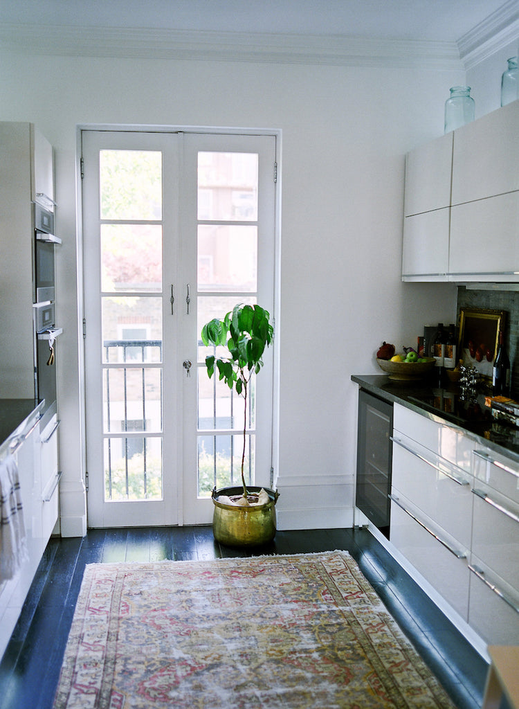 Heather's kitchen in Victorian Notting Hill flat with antique rug
