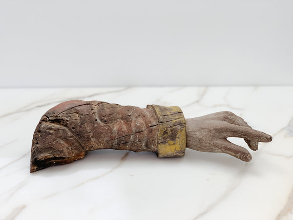 Hand-carved arm of a Saint