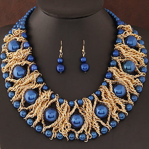 Pearl necklaces in Red and Royal blue too.
