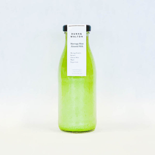 glass bottle of almond milk moringa milk drink 250ml