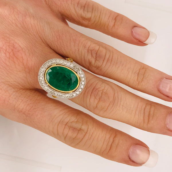 Large oval emerald diamond gold ring
