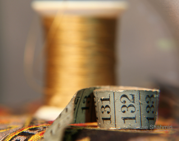 measuring tape and thread