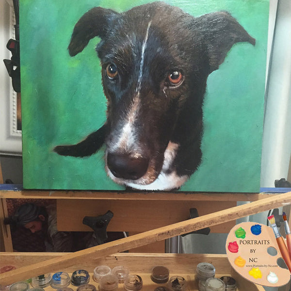black-dog-painting-on-easel