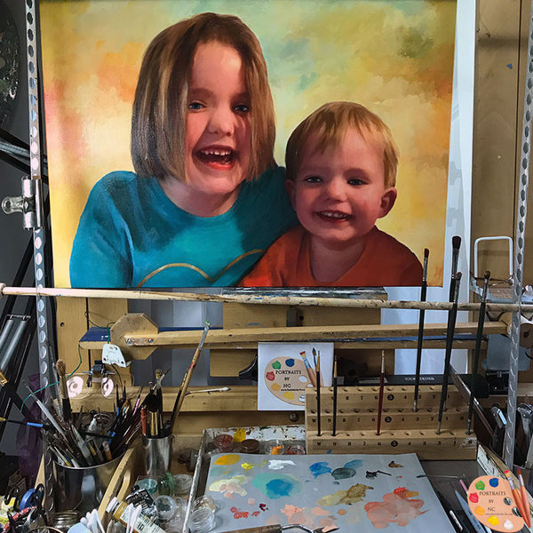 painting-of-kids-on-easel