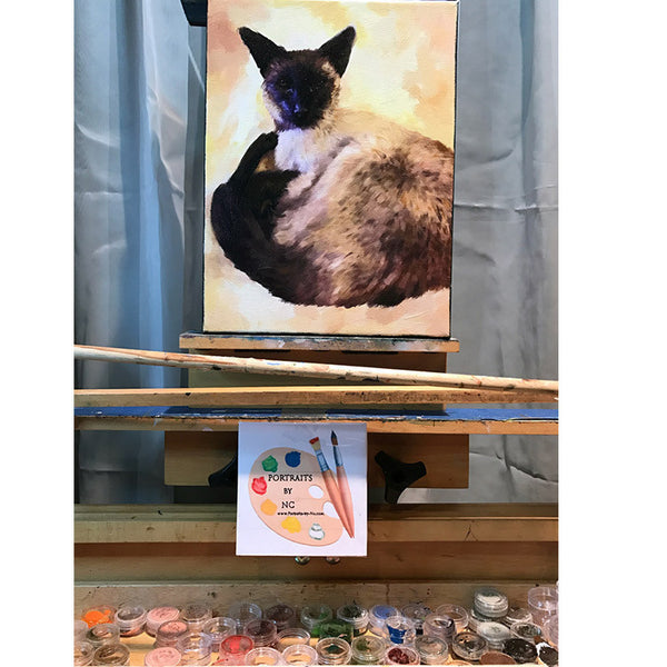 Siamese Cat Painting On Easel