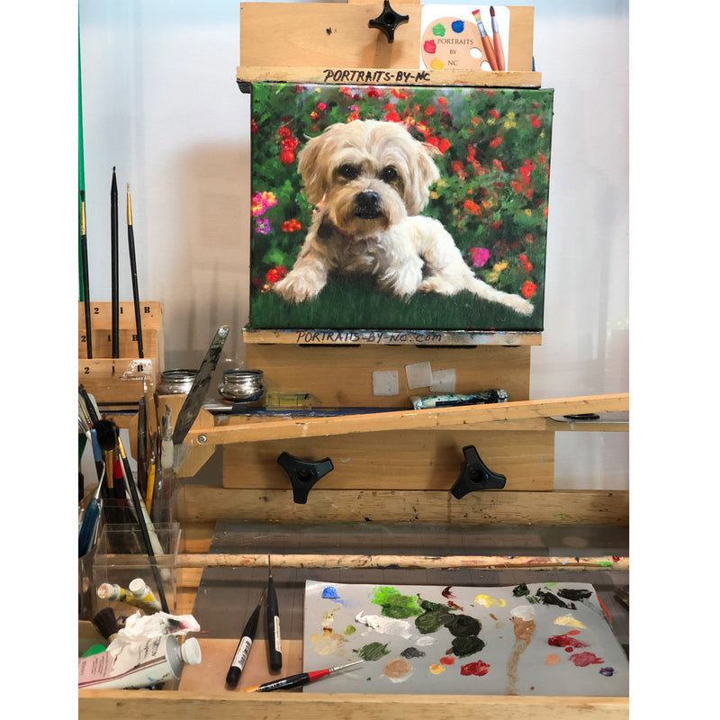 Lhasa Apso/poodle mix painting on easel