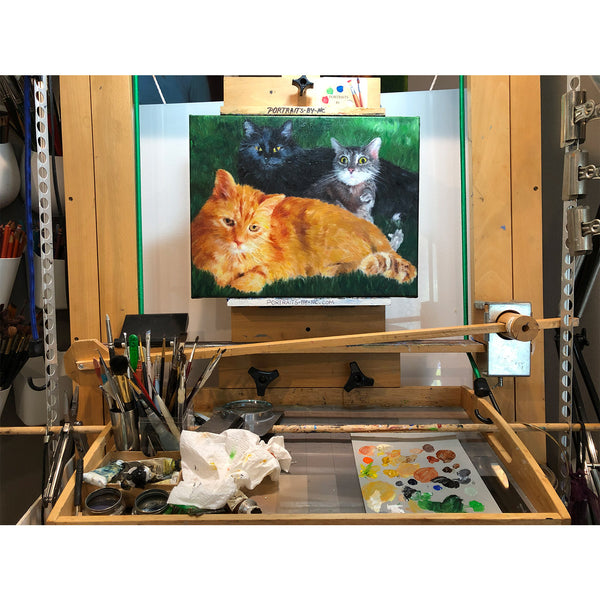 Cat painting on easel 684