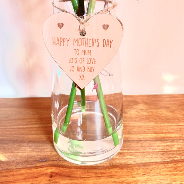 Tall glass vase and rose flower arrangement