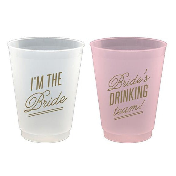 bride and bride's drinking team pink and white cups
