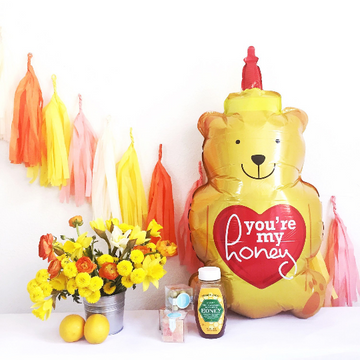honey bear bottle shaped balloon with paper tassels, party decorations