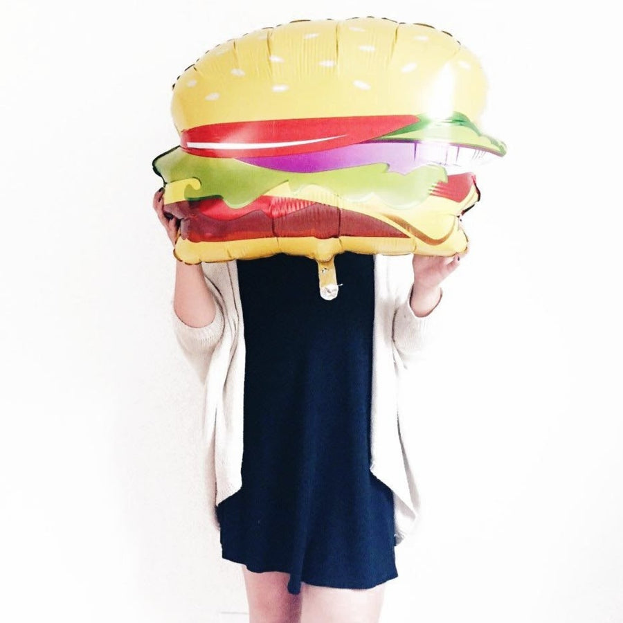 girl holding hamburger balloon