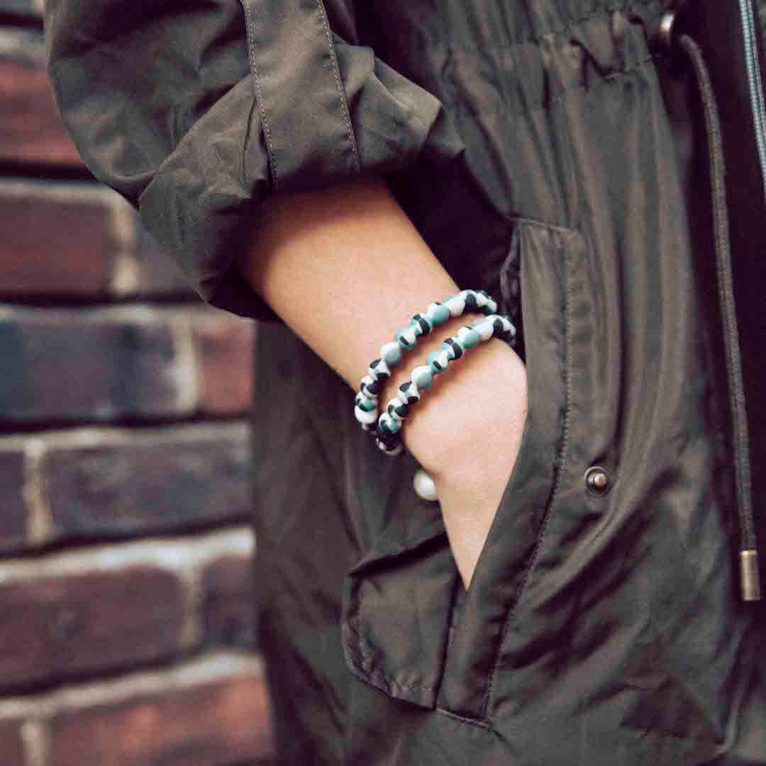 Woman in Jacket wearing Veterans Lokai