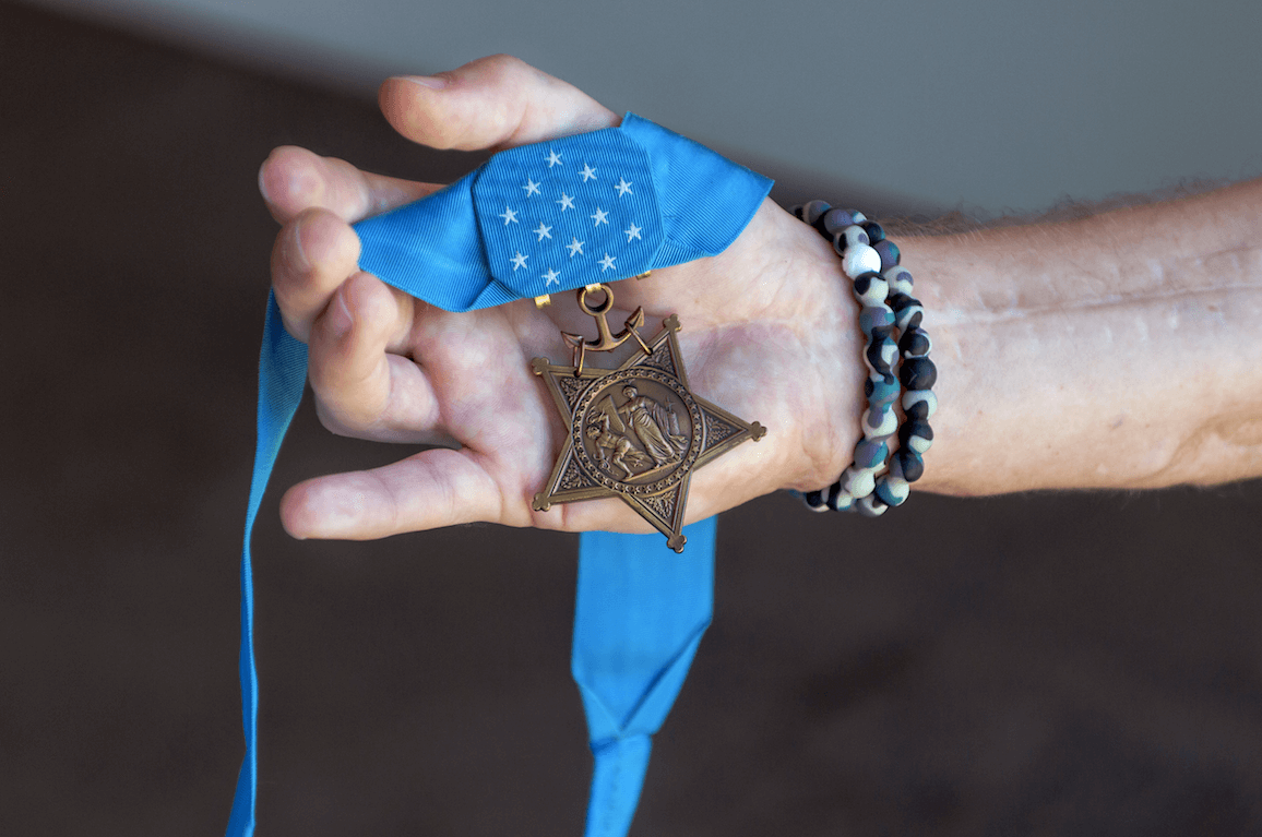 Hand holding Medal of Honor