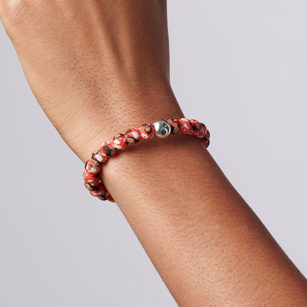Close up of silicone beaded bracelet with Moana pattern on a person's wrist