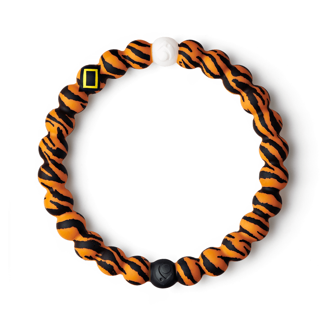 Silicone beaded bracelet with tiger pattern on it.
