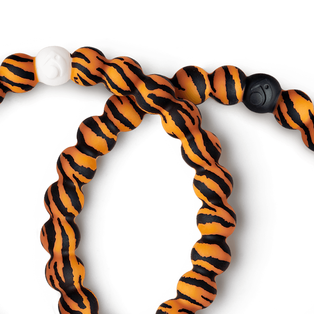 Close-up of silicone beaded bracelet with tiger pattern on it.