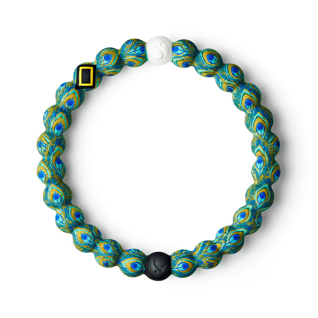 Silicone beaded bracelet with peacock pattern on it.