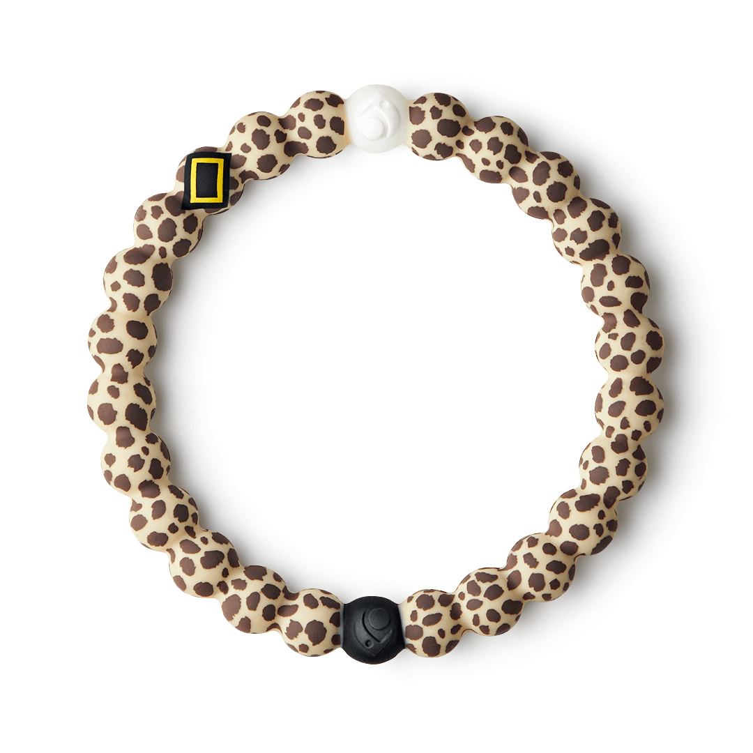 Silicone beaded bracelet with cheetah pattern on it.