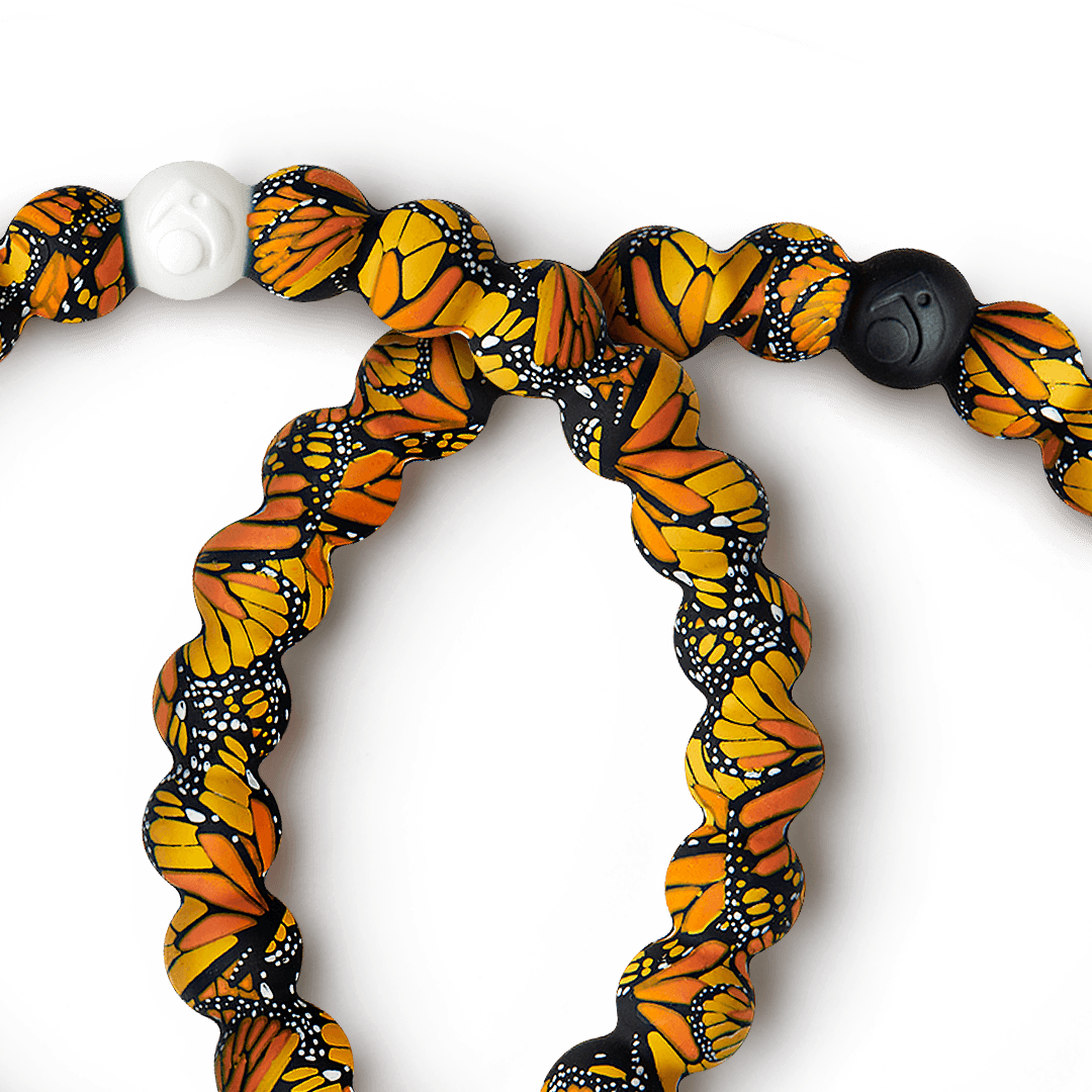 Close-up of silicone beaded bracelet with butterfly pattern on it.