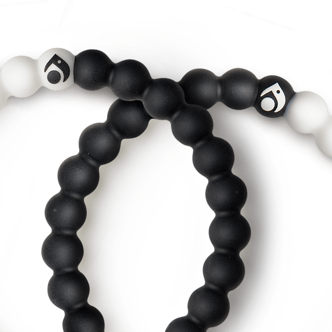Close-up of a black and white silicone beaded bracelet.