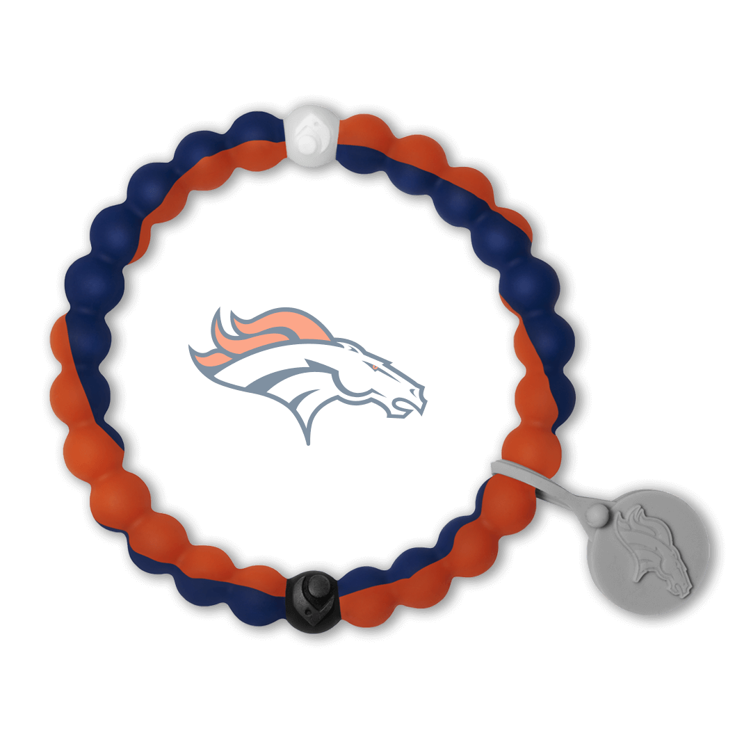 Male wearing a blue and orange silicone beaded bracelet on wrist while holding a football.