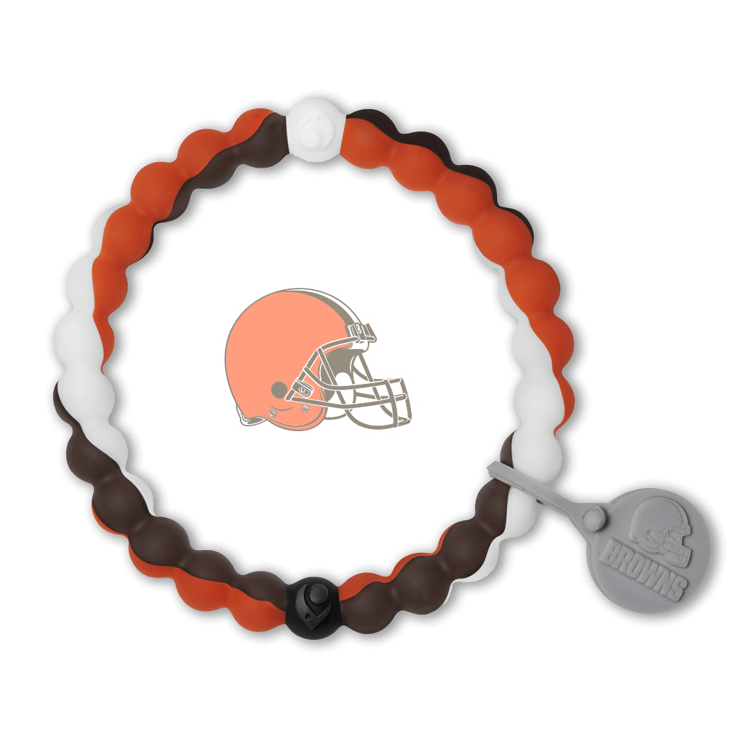 Male wearing a brown, white and orange silicone beaded bracelet on wrist while holding a football.
