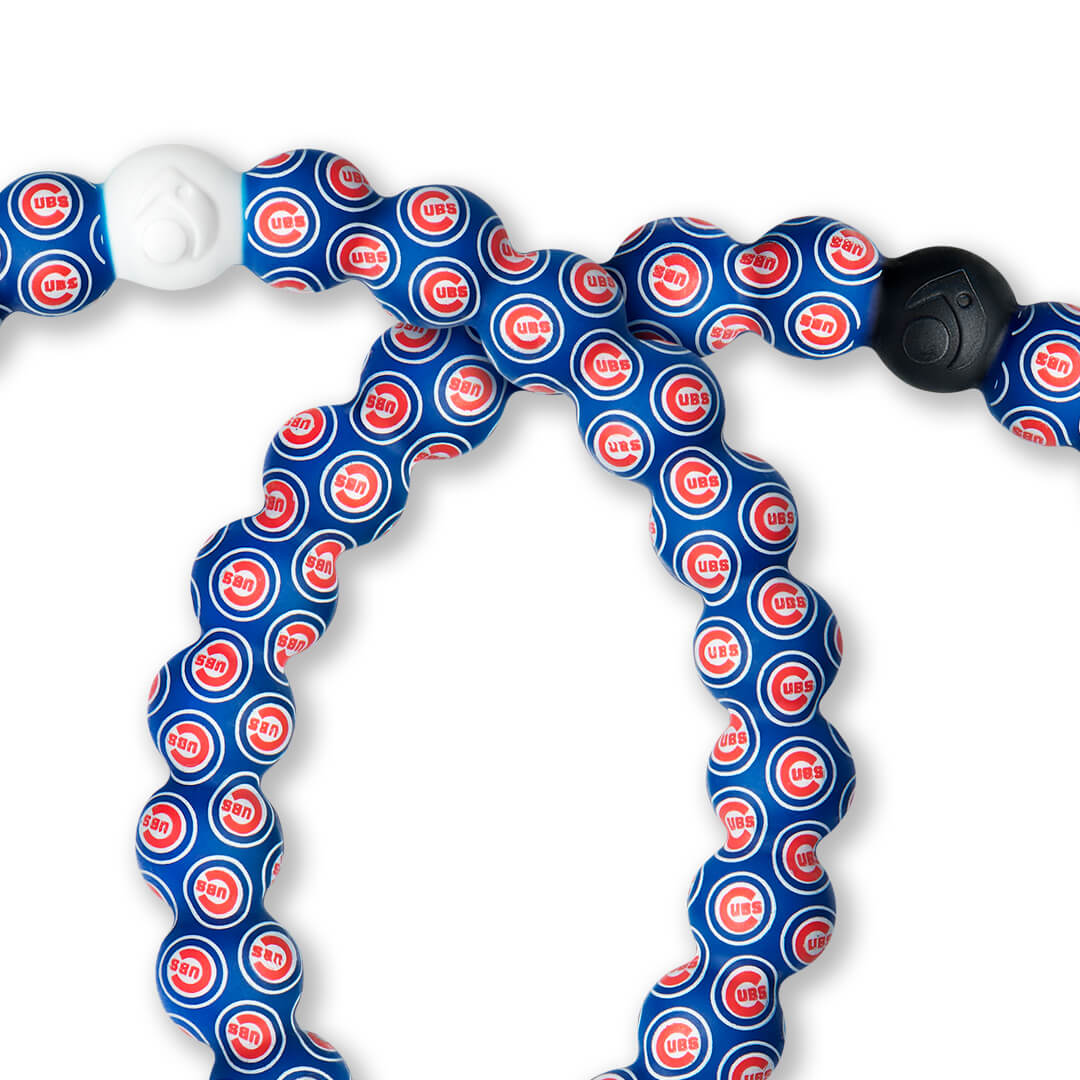 Close up of silicone beaded bracelet with Chicago Cubs logo pattern.