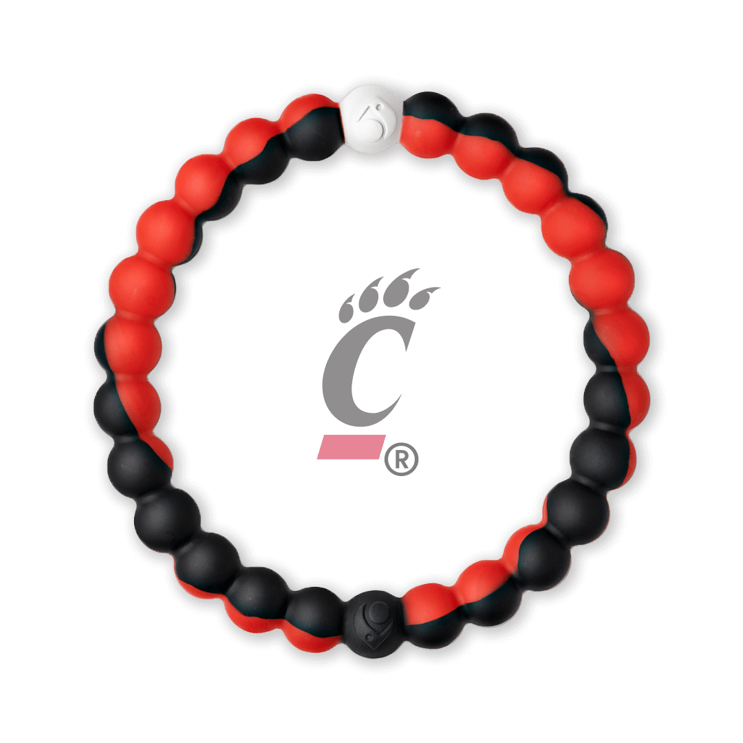 Red and black silicone beaded bracelet with the University of Cincinnati logo in the center.