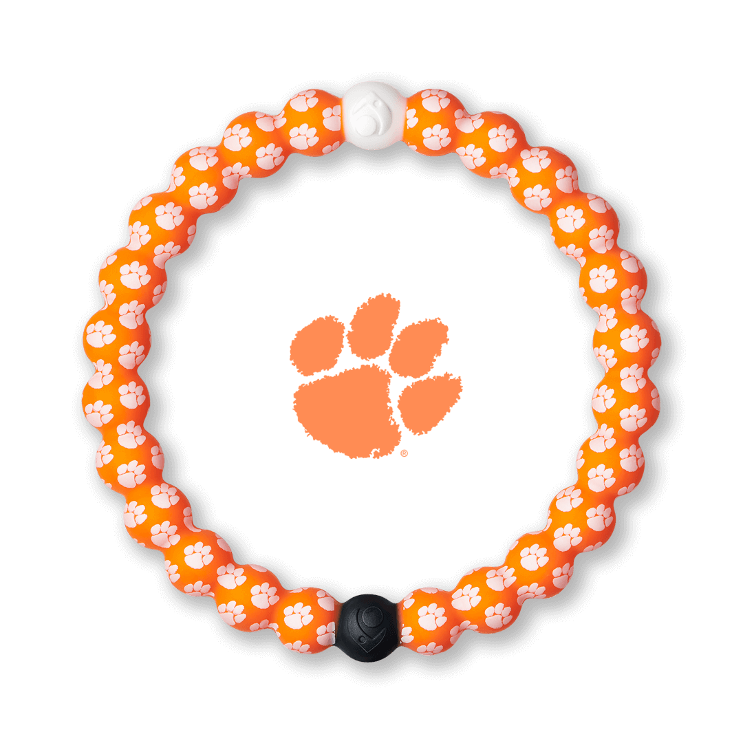 White and orange silicone beaded bracelet with the Clemson University logo all over it.