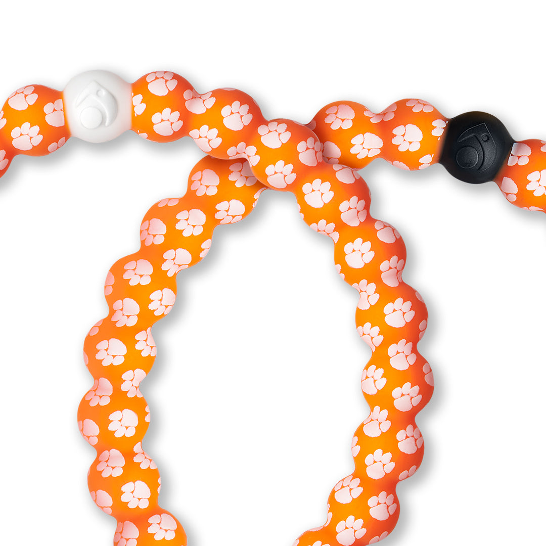 Close-up of white and orange silicone beaded bracelet with the Clemson University logo all over it.