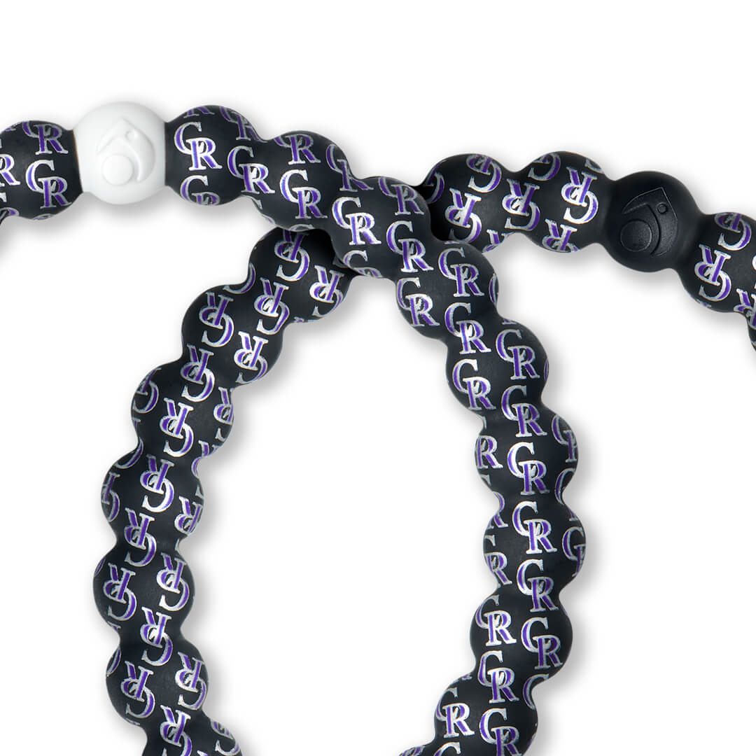 Close-up of silicone beaded bracelet with Colorado Rockies logo pattern.