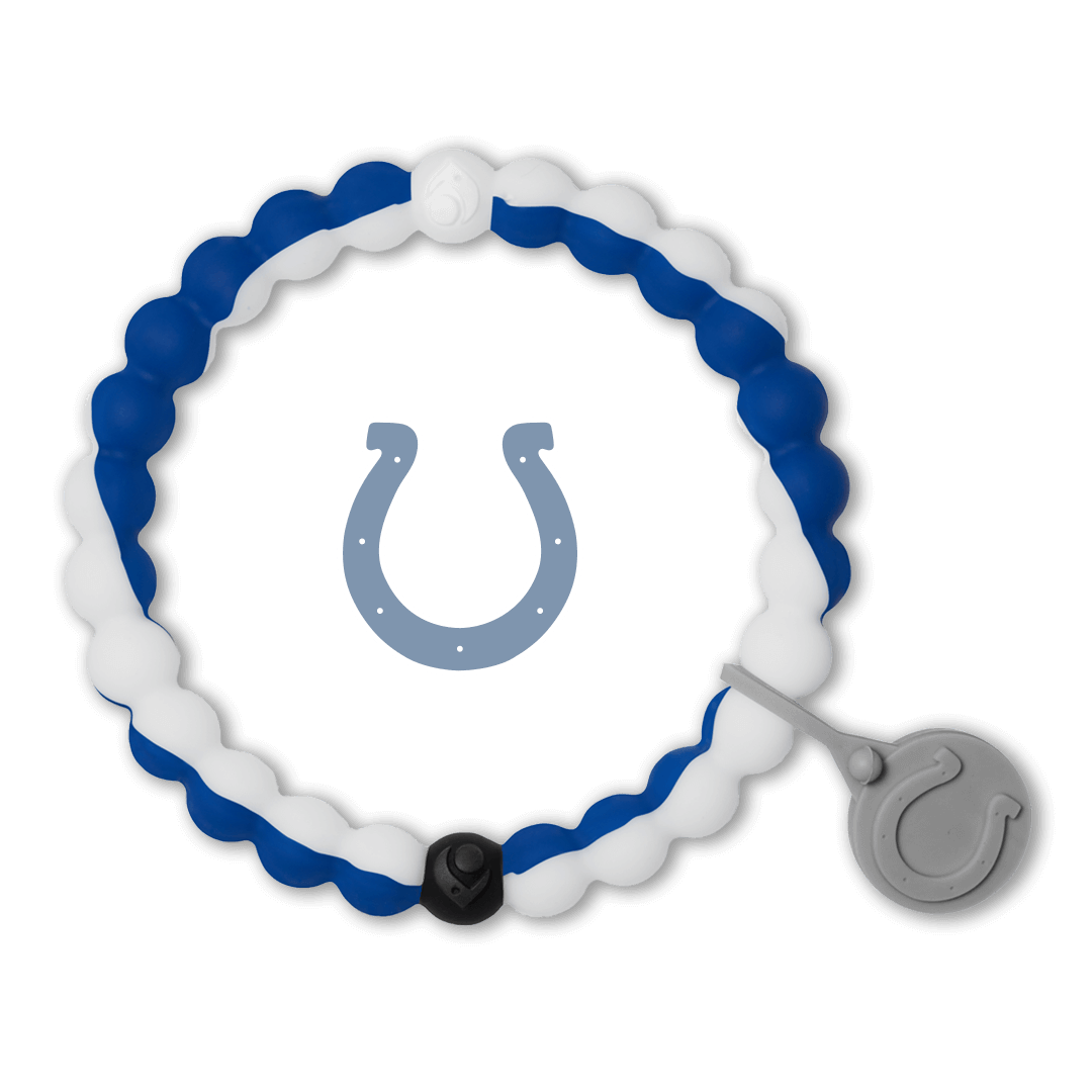 Male wearing a blue and white silicone beaded bracelet on wrist while holding a football.