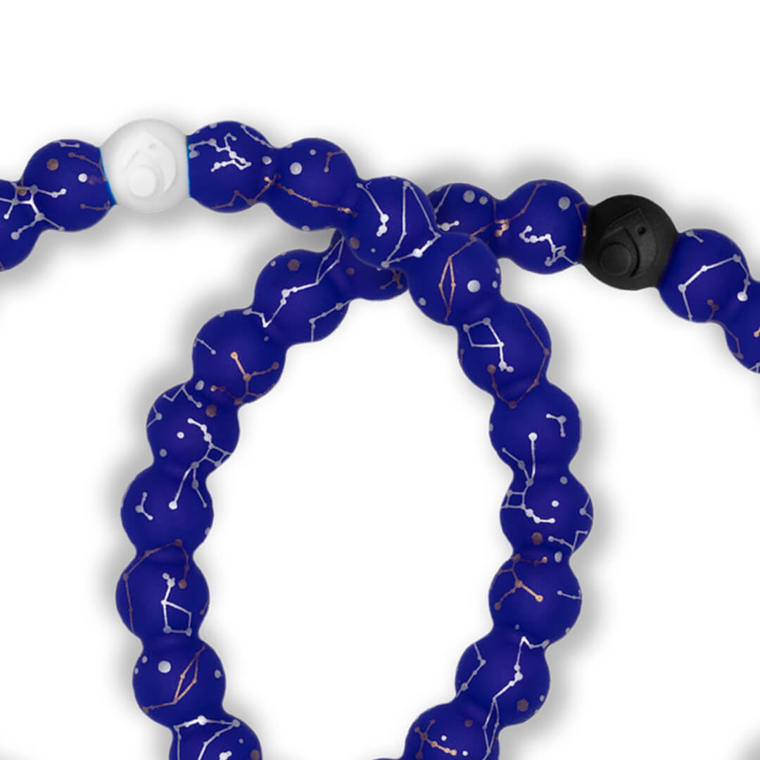 Close up of silicone beaded bracelet with Constellation symbol pattern.