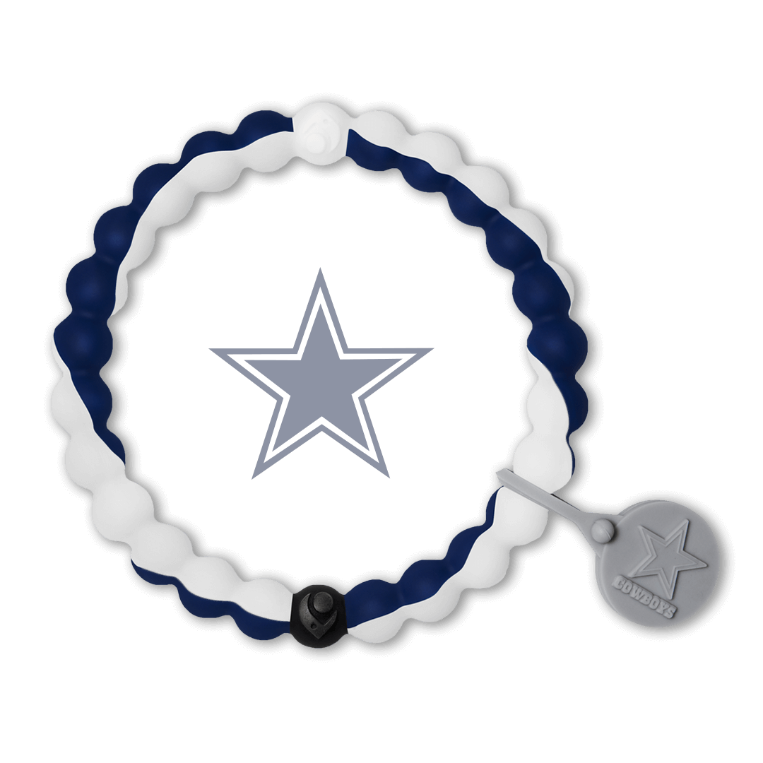 Male wearing a navy and white silicone beaded bracelet on wrist while holding a football.