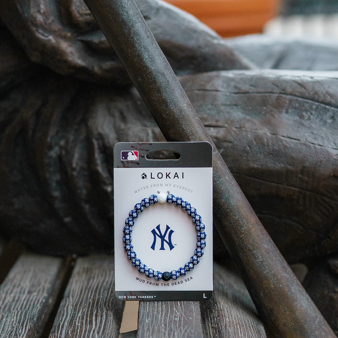 Carded back of a silicone beaded bracelet with New York Yankees Logo pattern.
