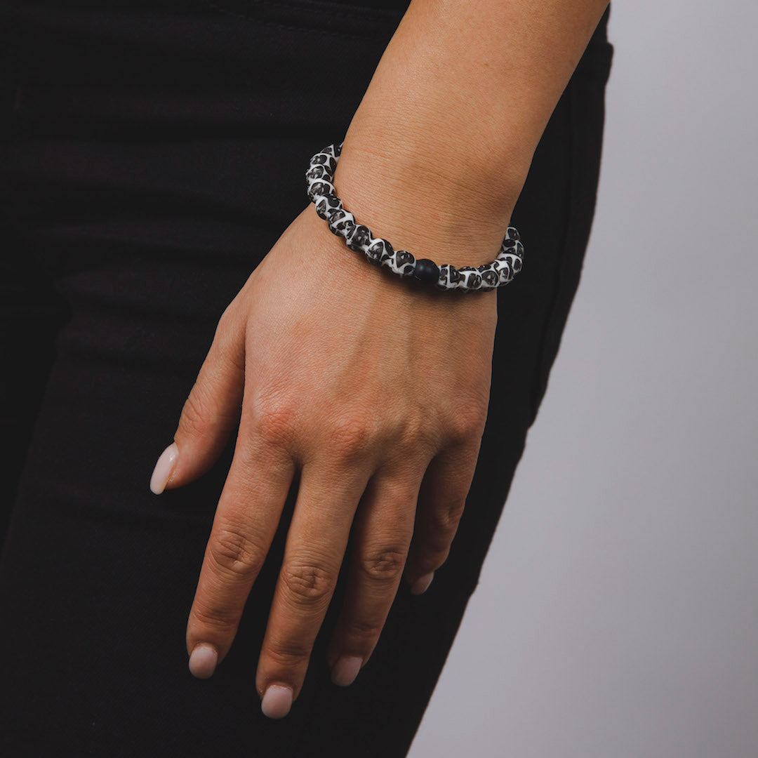 Woman wearing silicone beaded bracelet with Darth Vader pattern on wrist.