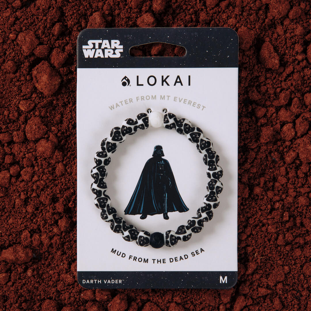 Silicone beaded bracelet with Darth Vader pattern on carded packaging.
